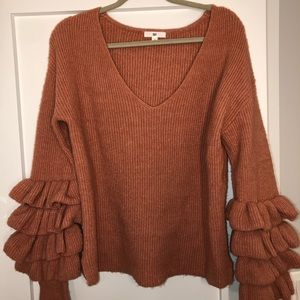 Burnt orange sweater with frill sleeves